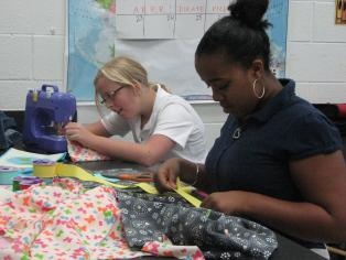 Students sewing gift bags