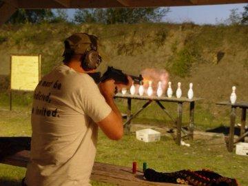 Todd shooting shotgun